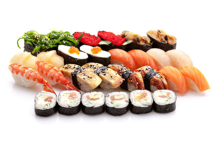 various types of japanese sushi on white background photo