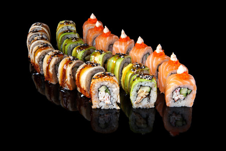 set of sushi rolls on black background