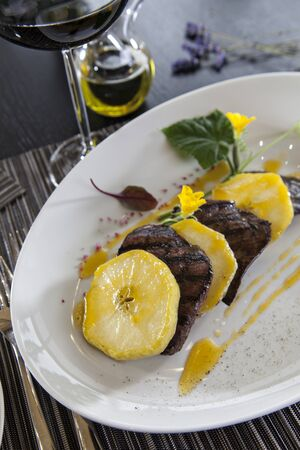broil: haute cuisine served dish with grilled foie gras and caramelized apples Stock Photo