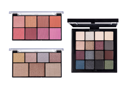 cosmetic product: Make up glamour powder and eyeshadows palettes on white background