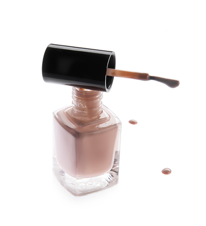 Elegant bottle with nail polish, trendy color, with a stroke, on a white background Stock Photo