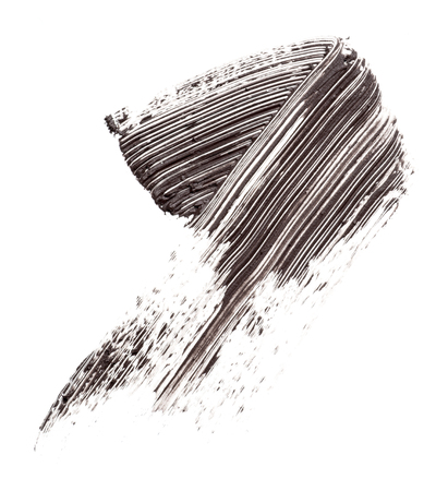 in vain: cosmetic products smear paint of mascara on a white background Stock Photo