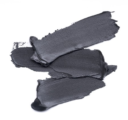 Black smear of cosmetic products on a white background