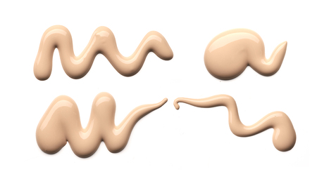 Collection of beige smear crushed cosmetic products on a white background Stock Photo