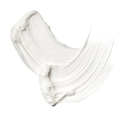 smear paint of white cosmetic products on a white background