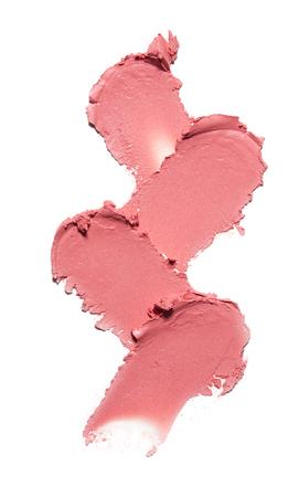 분홍색 얼룩의 컬렉션은 흰색 배경에 화장품을 짓 눌린