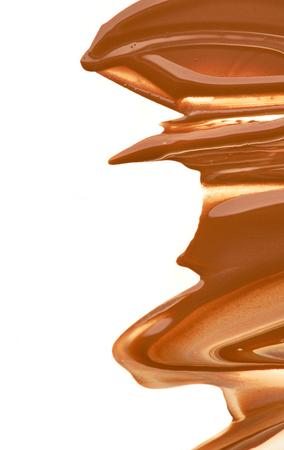 paleta de caramelo: pintura mancha de productos cosméticos en un fondo blanco Foto de archivo