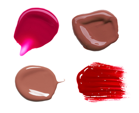 vermeil: smear paint of cosmetic products on a white background