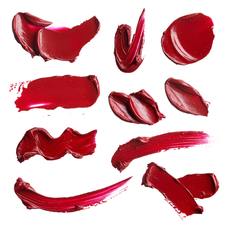 set of smears from various cosmetic products on a white background