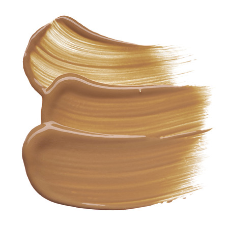 Stunning and exclusive smears and texture made with beige (brown) foundation on white background. Smears of beige (brown) foundation for smoothing skin color, on white background
