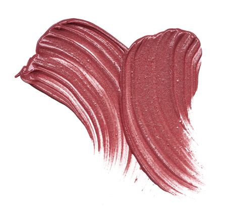 Stunning and exclusive smears and texture made with expensive burgundy lipstick on white background. Strokes burgundy lipstick or rouge for facial make-up, on a white background