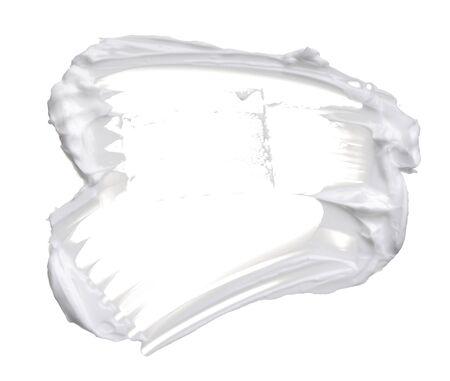 White creamy texture isolated on white background. Smear of face cream on white background
