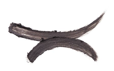 Dark brown smear of crushed eye shedow on a white background. Texture of crushed brown eye shedow on a white background