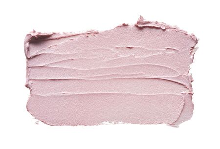 Pink makeup smear of creamy foundation isolated on white background. Pink creamy foundation texture background