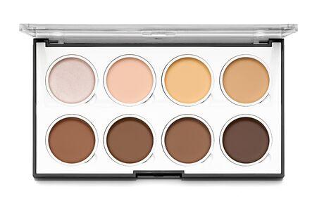 Set of highlight and contour cream in palette isolated on white background Banco de Imagens
