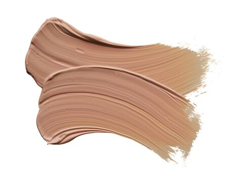 Gently beige strokes and texture of makeup foundation or acrylic paint isolated on white background