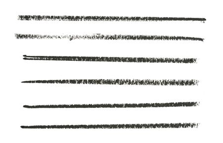 Black pencil strokes on white paper texture directly above shot