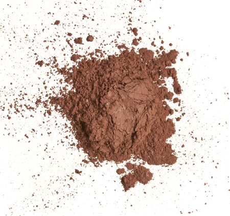 Texture of brown eye shadow isolated on white background. Macro texture of broken brown powder