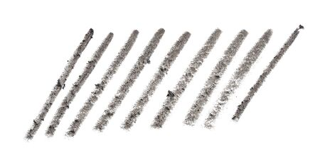 Grey pencil strokes on white paper texture directly above shot
