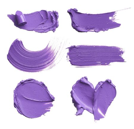 Smears of different colors are made with various cosmetic products isolated on a white background