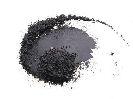 Texture of broken black eyeshadow or powder. Macro texture of broken black powder, background Foto de archivo