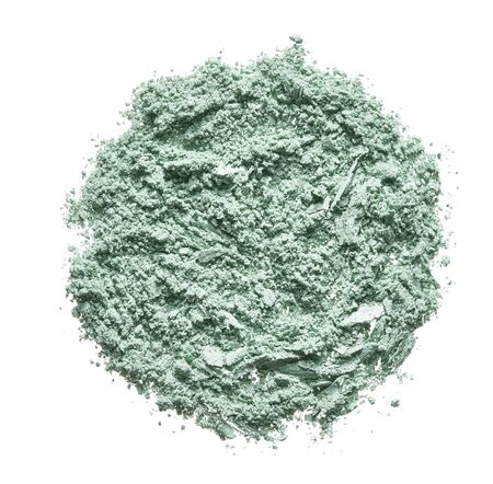 Texture of broken colorful eyeshadow, blush or powder. Macro texture of broken green powder, background