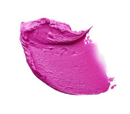 Macchia e consistenza di rossetto rosa o vernice acrilica isolati su sfondo bianco.