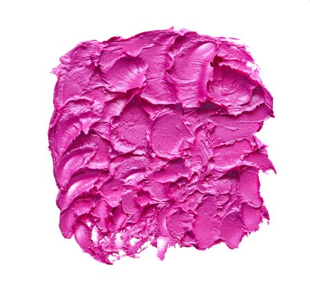 Smear and texture of pink lipstick or acrylic paint isolated on white background.