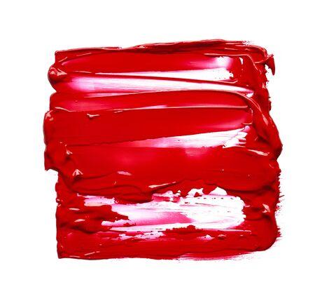 Frottis et texture de rouge à lèvres ou de peinture acrylique isolés sur fond blanc. Banque d'images