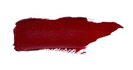 Frottis et texture de rouge à lèvres ou de peinture acrylique isolés sur fond blanc.