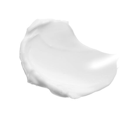 Smears and texture of face cream or white acrylic paint isolated on white background