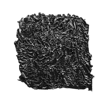 Texture of black crushed eyeliner or black acrylic paint isolated on white background
