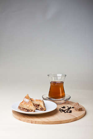 Turkish cake served with tea photo