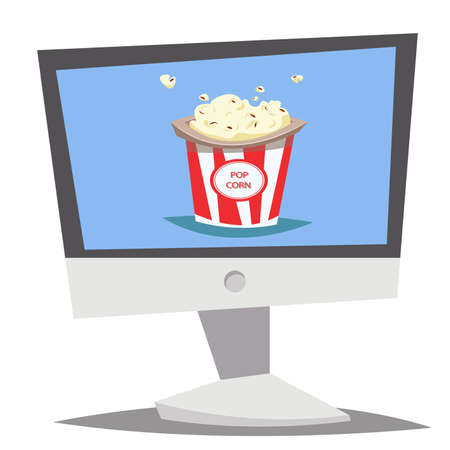 Computer with popcorn bucket on the desktop.