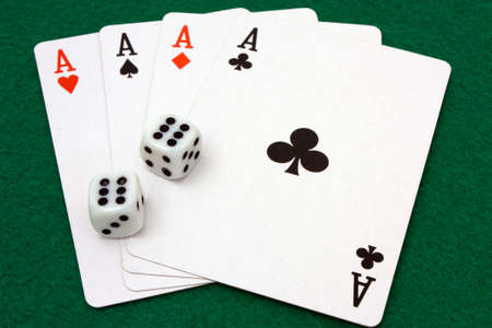 Card hand of four aces and dice rolled to double sixes