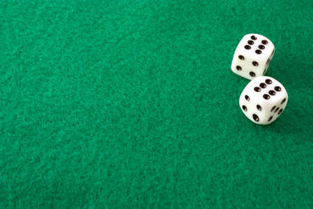 Dice rolled to double sizes on a green felt table