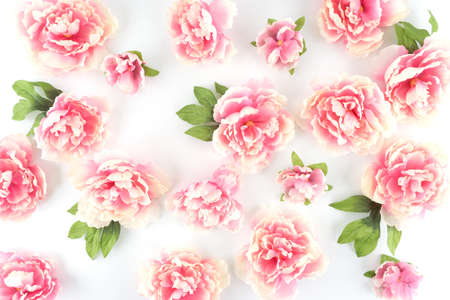 Pink peony flowers scattered on a white styled desktop silk pink peony flowers scattered on a white styled desktop silk artificial flowers crafts stock mightylinksfo