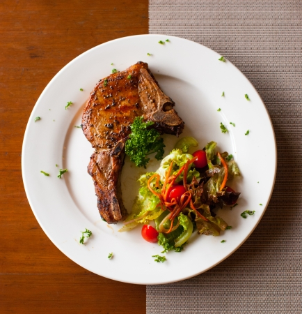 table top view: Pork chop with salad on table top view Stock Photo