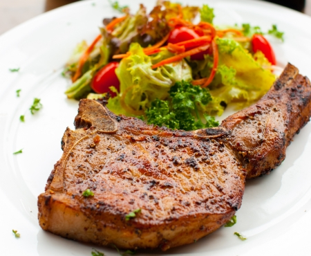Pork chop with salad close up