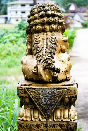 Behind Chinese Lion in temple with blue sky in Ranong,Thailand Stock Photo