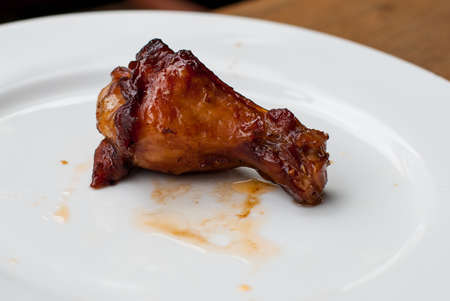 Grilled chicken wings on a  white dish photo