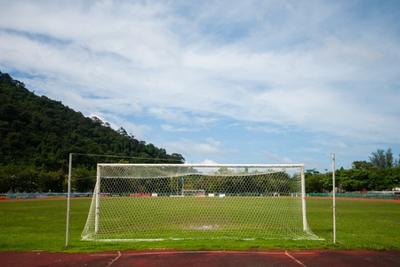 enfield: Empty soccer goal on a sunny day at Stadium