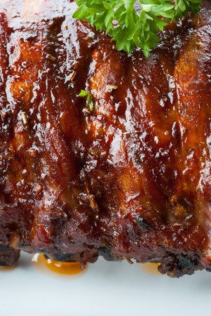 grilled juicy barbecue pork ribs and parsley  photo