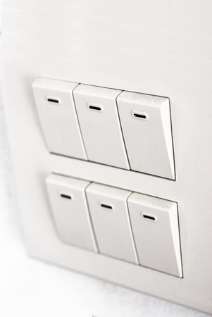 Light Switch on the wall white photo