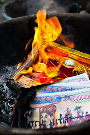 Burning paper for Hungry Ghost Chinese Festival Stock Photo