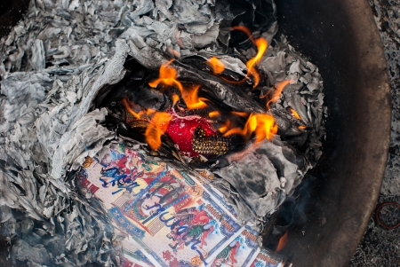 money to burn: Burning paper for Hungry Ghost Chinese Festival Stock Photo