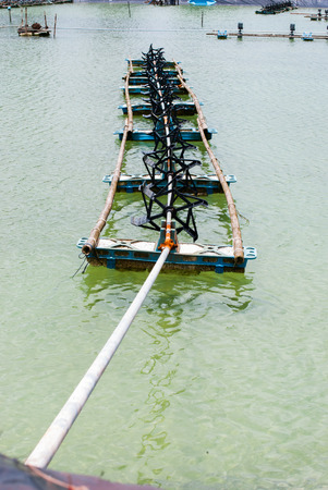 aeration turbine generate oxygen in shrimp farm photo