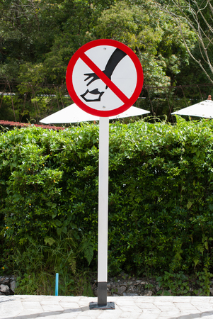 littering: a littering prohibited signal in the garden