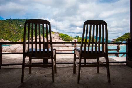 Wooden chairs on the beach at Koh Nang Yuan, Thailand  photo