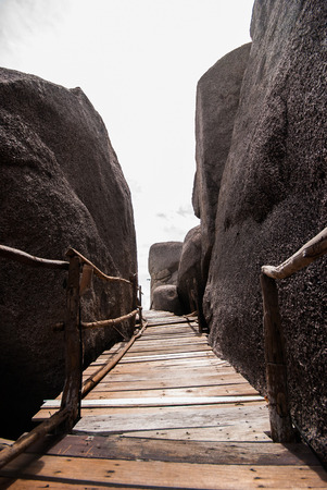 nang: wooden bridge with rock at Koh Nang Yuan, Thailand